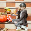 Stock Photo: Little girl having a picnic on stairs