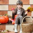 Little girl sitting on stairs outdoors — Stock Photo