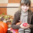 Portrait of little girl with apple and pumpkin — Stock Photo