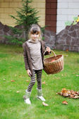 Little girl posing outdoors with basket — Stock Photo