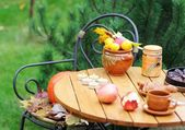 Wooden table set in garden setting — Stock Photo