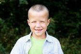 Closeup portrait of cute boy posing outdoors — Stock Photo