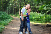 Brothers hugging each other outdoors — Stock Photo