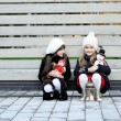 Little girls in warm outfit posing outdoors — Stock Photo