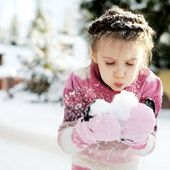 Little girl having fun with the snow — Stock Photo