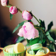 Still-life photo with cups, macaroons and peony — Stock Photo #24473011