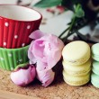Still-life photo with cups, macaroons and peony — Stock Photo #24492863