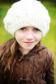 Child girl in white cap, close-up portrait — Stock Photo