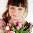 Portrait of child girl with tulips — Stock Photo #9450138