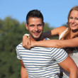 Young women hugging her boyfriend in the park — Stockfoto
