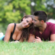 Portrait of a young couple lying on the grass — Stock Photo