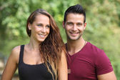 Happy young couple smiling outdoor — Stock Photo