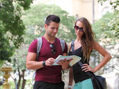 Young couple watching the city map — Stok fotoğraf