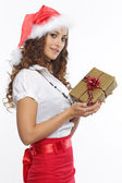 Beautiful red dressed woman with a present — Stock Photo