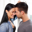 Stock Photo: Loving couple smiling at each other