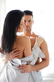Man hugging his half naked girlfriend — Stock Photo