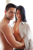 Handsome man holding his sexy girlfriend — Stock Photo