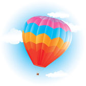 Colorful hot air balloon on blue sky — Stock Vector