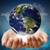 Holding a earth on hands. Earth image provided by Nasa. — Stock Photo