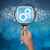 Gear icon in Magnifying glass ,business background — Stock Photo