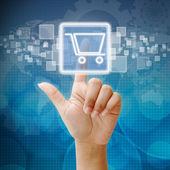 Mão pressione sobre o ícone do carrinho de compras — Foto Stock