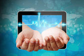 Electrocardiogram on hand pushing out of tablet-pc — Foto Stock