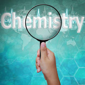Chemistry , word in Magnifying glass , background medical — Stock Photo