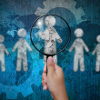 Постер, плакат: Choosing the talent person for hiring in magnifying glass
