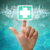 Hand press on First Aid Symbol , medical background — Stock Photo