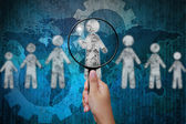 Choosing the talent person for hiring in magnifying glass — Stock Photo