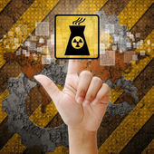 Hand press touch Nuclear power symbol on industry background — Stock Photo