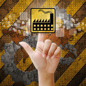 Hand press touch factory symbol on industry background — Stockfoto