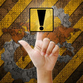 Hand press touch warning sign on industry background — Stock Photo
