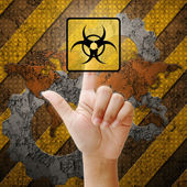 Hand press touch nuclear symbol on industry background — Stock Photo