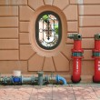 Stock Photo: Hydrant with water hoses and fire extinguish equipment