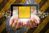 Hand woman pushing out of tablet-pc on industry background — Photo