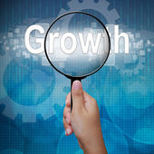 Growth, word in Magnifying glass; business background — Stock fotografie