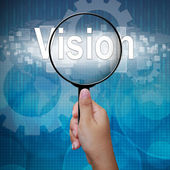 Vision, word in Magnifying glass ,business background — Photo