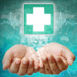 First Aid Symbol on hand, medical background — Stock Photo