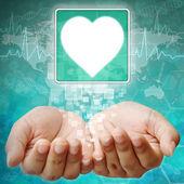 Heart Symbol on hand , medical background — Stock Photo