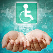 Disabled Symbol om hand,medical background — Stock Photo