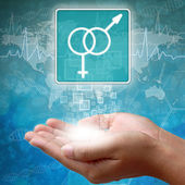 Medical icon Male and female in hand — Stock Photo