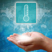 Medical icon Thermometer in hand — Stock Photo