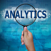ANALYTICS in Magnifying glass on blue background — Stock Photo