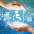 Medical icon, Disabled symbol in hand — Stock Photo