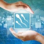 Medical icon, Spermatozoon symbol in hand — Stock Photo
