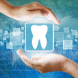 Medical icon, Tooth symbol in hand — Stock Photo