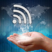 Wifi symbol on hand — Stock Photo