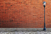 Lamp post street on brick wall background — Stock Photo