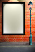 Lamp post street and blank billboard on brick wall — Stock Photo